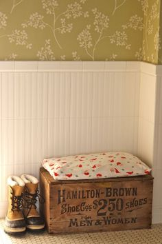 Antique bench with vintage pillow on top