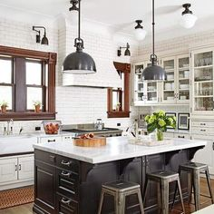 tile to ceiling, no uppers on window wall, dark sills + island, gorgeous!
