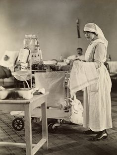 A nurse cleans medical instruments in the WWI American hospital in Neuilly, France ~