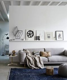 comfy couch and artworks