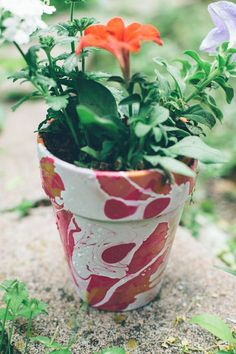 DIY Planters with Nail Polish Marbling- Turn a boring planter into a work of art. This garden craft is perfect for spring and summer.