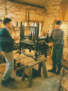 Conservator-craftsmen working on a Chair from Hereford Cathedral, reported to have been used in 1138 by King Stephen.