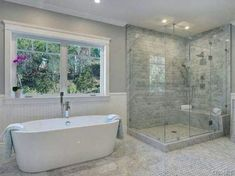 Nice and open. Like the window above the tub and the all-glass shower is nice too!
