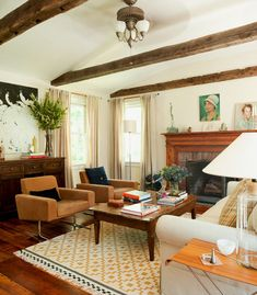 love the exposed beams, that rug (ikea i think), and that sturdy, worn wood coffee table