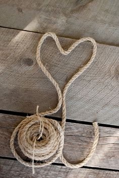 Create a tabletop display using rope. And give it a holiday touch by creating a heart for Valentines Day or an Anniversary; pumpkin for fall or a star for Christmas.