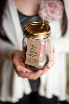 """These party favors were made for a peanut themed baby shower I threw for a friend. Inside the mason jar was dirt and a packet of seeds for the party goer to plant. A little reminder of the little """"peanut"""" they were there to celebrate. There were peanuts everywhere, I tell you!"""