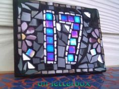 I love mosaics...a house number in mosaic would be lovely.