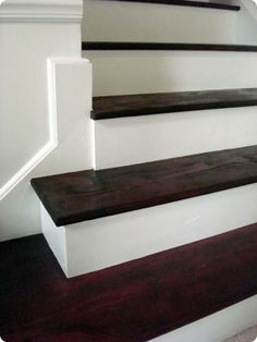 """A gorgeous coat of #stain for the tops of these #stairs, sitting on the #contrasting white base, transforms a forgotten staircase into quite a """"step up!"""""""