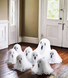 To call forth this gathering, use glue dots to stick construction-paper eyes and mouths onto white tissue-paper wedding bells, then drape them with cheesecloth.  Read more: Halloween Craft Ideas for Kids - Halloween Craft Projects - Country Living