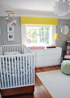 The room is already painted yellow. I like the gray with the yellow. Also, I like the use of Ikea furniture with the baby furniture.