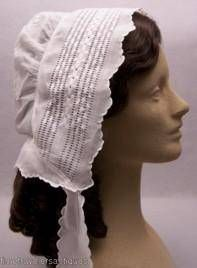 1850 lady's snow white muslin day cap with beautiful drawnwork and embroidered sprig whitework. Piped at the crown, with a fine inner curtain drawstring and streamers with scalloped button holes edges that match the trim of the cap.