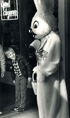Boy looking at Easter Bunny