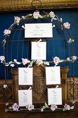 Wedding seating chart in a birdcage frame.