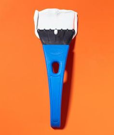 Hide your picture-hanging mistakes. Smooth wall filler into nail holes and small cracks with an ice scraper.
