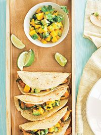 Tacos are topped with cool fruit salsa.