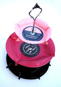 Handmade jewelry/treat stand made from recycled vinyl records by   @artistkatieblue on Etsy.