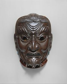 Mask  Inscribed by Myōchin Muneakira  (Japanese, Edo period, 1673–1745)   Date:dated 1745Culture:JapaneseMedium:Lacquered iron, silkDimensions:Length, 9 1/2 in. (24.13 cm) Width, 7 in. (17.78 cm)Classification:Armor PartsCredit Line:Rogers Fund, 1919Accession Number:19.115.2  http://www.metmuseum.org/Collections/search-the-collections/40000944?rpp=20=1=370=*=7