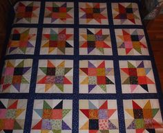 Half Square Triangle Star Block Quilt.  This is one of the easier quilt blocks to make but I think it is so stunning when done in a scrappy style.  Peace, Robert from Nancy's Fabrics.