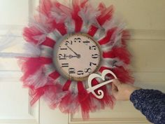 """This was a custom order for a fellow military wife. She wanted a New Years wreath with red and silver tulle and told me to get """" creative """". I love it!! This one is hard to give up."""
