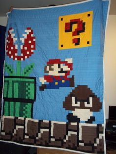 """Mario! It drives me nuts to see so many of these quilts that are pieced square by square.... just strip piece it, and have the quilting be a grid to get the """"pixel"""" effect. Much less waste and hassle that way!"""