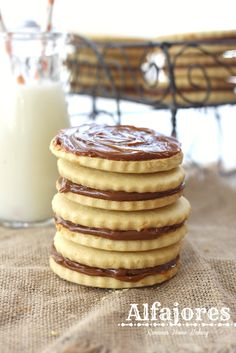 Alfajores, also known as dulce de leche sandwich cookies, are traditional shortbread cookies with a dulce de leche filling from Roxanashomebaking.com @RoxanaGreenGirl | Roxana's Home Baking | Roxana's Home Baking