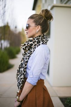 I normally don't like animal print because it can look cheesy, but paired with this outfit, sunglasses, and hairstyle it pulls the whole outfit together and makes it classy. safari outfits, high bun outfit, anim print, top bun outfit, animal prints, leopard scarf outfit, outfits with sunglasses, leopard prints, outfits with leopard scarf
