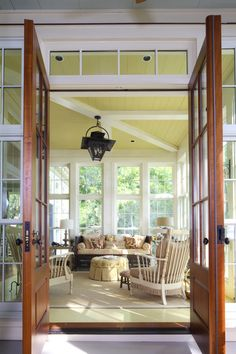 Enclosed porch...love the yellow ceiling
