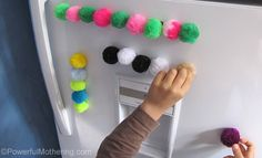 Use simple magnetic pom poms to do an activity in the kitchen on the fridge with your kids. Count, color sort, pattern and discover sticking.