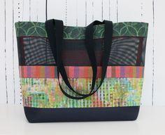Kaffe Fassett stripe, Marcia Derse print, batik. I used pet-screen material for the foundation