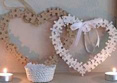 This is a sweet idea... puzzle piece heart wreaths
