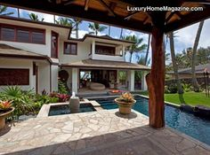 One-of-a-kind, resort style home with tropical hard-wood floors, Merbeau windows and doors, sub-zero and bosch appliances, and the finest amenities possible. The home has been designed around a central courtyard area with pool, spa, bali cabana, firepots, and spilling water fountains.