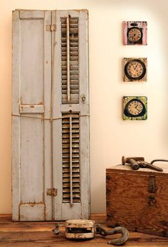 Old White Shutters...old wooden box...rusty pulley & painted wood wall...clocks.