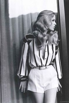 70's Editorial In A Striped Button Up And High Waisted White Shorts
