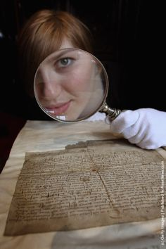 Charlotte Roirdan from Lyon & Turnbull views a letter written by Mary Queen of Scots on March 8, 2012 in Edinburgh, Scotland. The 450 year old letter, unearthed in Blair Castle in Ayrshire, has been verified as the hand writing of Mary Queen of Scotts and has been valued at 3,000 GBP. The letter, dated March 20, 1554, relieves the then laird of Blair from his duties due to gout