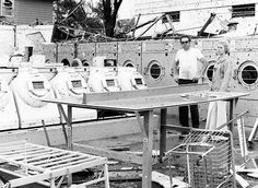 Joe and Marilyn Gasnick, owners of the J & M Laundromat at 7080 Blondo St., stand among what is left after a May 1975 tornado. There were five customers in the building when the tornado hit. Marilyn Gasnick had them all follow her to her basement located one door east of the laundromat. They all came through the storm safely despite heavy damage to the home and complete destruction of the laundromat. THE WORLD-HERALD