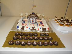 Hockey cake  theme with Happy Birthday pucks and cup cakes