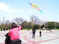 Mom and daughter playing kite
