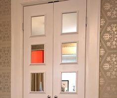 apply mirrors and molding to flat paneled doors - this image shows a bi-fold disguised as two hinged doors