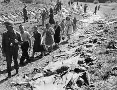 Victims of a forced march; Victims of a forced march between concentration camps of Buchenwald and Flossenburg, 1945. In this photograph taken in April 1945, German civilians are being forced to file past the bodies of victims murdered at the village of Namering by SS guards during a forced march from Buchenwald and Flossenburg concentration camps.