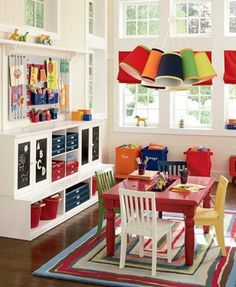 Kids playroom ideas. great shelves and colorful tables and chairs. Shelf above inspiration board.