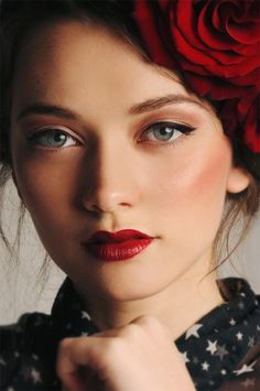 Winged eyes + red lips