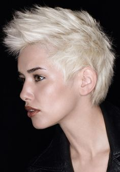 hair - white blonde spiky pixie, fair skin, dark eyebrows