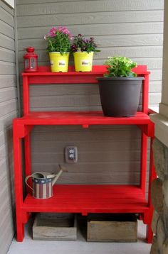 Totally love the fact that it is red.     Simple Potting Bench | Do It Yourself Home Projects from Ana White
