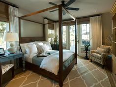 HGTV Dream Home 2013: Master Suite Bedroom Pictures : A canopy poster bed, fashioned from mindi wood with Parson-style posts and a horizontal planked headboard, serves as the room's focal — and jumping off — point for the room's design sensibility.
