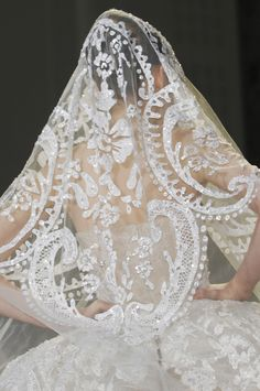 Hand appliqued and beaded veil. Elie Saab Spring 2013 Haute Couture