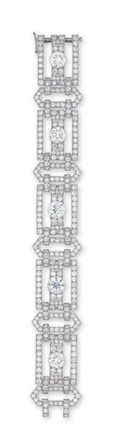 A DIAMOND BRACELET  DESIGNED AS A SERIES OF OPENWORK OLD EUROPEAN AND SINGLE-CUT DIAMOND GEOMETRIC LINKS, EACH CENTERING UPON A COLLET-SET OLD EUROPEAN-CUT DIAMOND, MOUNTED IN PLATINUM, 18.4 CM LONG