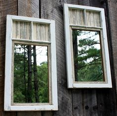Outdoor Mirror used on fence to reflect wooded area against solid wall or fence