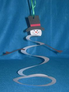 Cute spiral snowman idea for those who can hang creations from the ceiling.