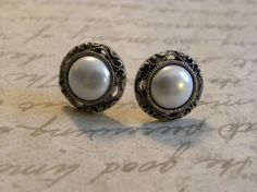 Pearl Filigree Stud Earrings by BrittanyMarieJewelry. Reminds me of my engagement ring ;)