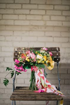 lush bouquet with paper flowers, photo by Altmix Photography, styling by Juli Vaughn Designs http://ruffledblog.com/modern-atlanta-wedding #weddingbouquet #flowers